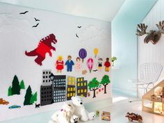 Perfect for a child's room: a felt activity wall. Wall is covered with batting, then felt. Mom & Dad or the child can create the shapes to decorate the wall. What fun!