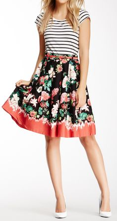We love bold and clashy prints. This floral midi skirt and stripy top clash but they look great together!