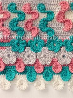 Diagram and pictures on how to crochet flowers directly into your crochet work.