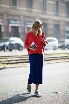 Candela Novembre This combination of red top and blue midiskirt makes primary colors look polished, especially with houndstooth sneakers. Photo: I'M KOO