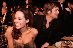 With Brad Pitt at the 2008 Screen Actors Guild awards, giggling again.   - ELLE.com