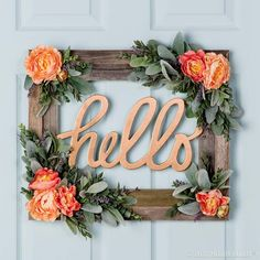 Create a rustic-meets-chic front door wreath with a barnwood frame, chipboard sign and faux florals!