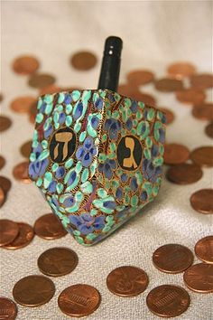 Beautiful painted dreidel (© Ray Kugler/AP) #budgettravel #travel #holiday #holidays #Hanukkah #Chanukah #winter #menorah www.budgettravel.com