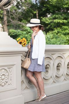 The Corporate Catwalk Summer in Central Park - The Corporate Catwalk. Black and white checked dress with ruffle+golden lace up ballerinas+white blazer+straw hat+beige bucket bag. Summer outfit 2016