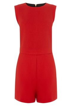We love the sharp, chic, tailored finish on this summer playsuit. The piece features flattering cap sleeves, a drop waist and pockets on the hips. The piece is finished with a concealed zip fastening on the reverse and faux pockets on the reverse.