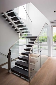 Architect Frits de Vries has designed the Mathers Avenue Residence, located in Vancouver, Canada Staircase Interior Design, Modern Interior Design, Interior Architecture, Butterfly Roof, Glass Stairs, Floating Staircase, Modern Stairs, Barn House Plans, Piece A Vivre