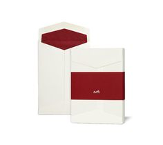 "Love:  Hermes box of 25 envelopes in vellum paper with white exterior, Hermes red interior and ""Hermes"" signature on outer. Intended for use with A5 size sheet, folded in half. C6 size. Measures 4.5"" x 6.4""."