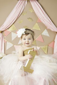Pink and gold birthday, cake smash, one year session. www.stacythompsonphotography.com