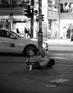Eine Spende Danke - A homeless man finds his place to rest for the night, Hamburg, Germany