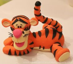 This is my Tigger. He is going on a Winnie the Pooh cake along with the Winnie the Pooh I posted recently. I still have Eeyore and piglet to make! I found Tigger's head quite hard to make. He looked a bit like a duck at first but gradually came. Fondant Cake Toppers, Fondant Figures, Fondant Cakes, Cupcake Toppers, Winnie The Pooh Cake, Winnie The Pooh Friends, Cake Topper Tutorial, Fondant Tutorial, Fondant Animals
