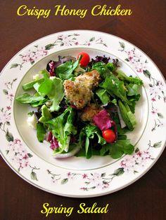 Crispy Honey Chicken Spring Salad for #SundaySupper- Sweet, crispy baked chicken on top of a Spring Mix salad full of favorite vegetables.