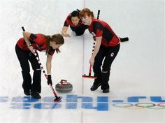 DAY 9:  (L-R) Kaitlyn Lawes, Jill Officer and Dawn McEwen of Canada compete during the Curling Women's Round Robin Session 8 - Canada vs. Japan