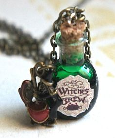 This necklace features a Witchs brew potion pendant. The glass vial/bottle pendant measures cm tall and is securely attached to a bronze chain necklace that measures 24 in length. A witch charm completes this piece. Bottle Jewelry, Bottle Charms, Bottle Necklace, Magic Bottles, Lighted Wine Bottles, Glass Bottle Crafts, Bottle Art, Beer Bottle, Halloween Potion Bottles