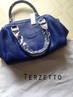 Terzetto, bright blue leather purse