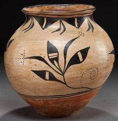 A COCHITI OR SANTO DOMINGO POLYCHROME STORAGE JAR  c. 1920    painted in black over a cream slip, with feather/foliate elements, each embellished with dotted details, encircling the body, and a ring of geometric motifs suspended from the rim, banded orange underbody