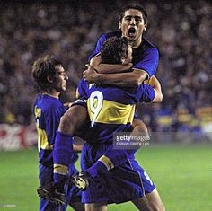Roman Riquelme(top) of Argentina's Boca Juniors soccer club celebrates his second goal against another Argentine team, River Plate, 24 May 2000 in their Copa Libertadores soccer tournament match in Buenos Aires. Hugging Riquelme is teammate Martin Palermo (No. 9). Boca Juniors defeated River Plate 3-0, to classify for the semifinals in the tournament.