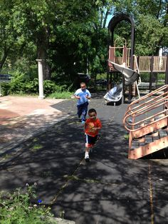 Carter, age 3, and Victorio, age 8, at the park. Submitted by Eileen. -- Choose your favorite photo and submit your vote by August 6, 2012 for a chance to win a gift card for children's books!