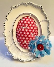 Mini Framed Pin Cushion. Find a metal framed one (paint with magnet paint), make it so it can lay flat. Keep the pin cushion part and you have a combined pin cushion.