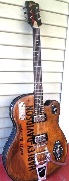Kurt Schoen reclaimed Harley Guitar --- https://www.pinterest.com/lardyfatboy/