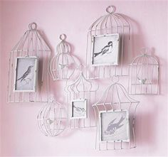 A montage of 7 joined birdcages holding 4 photo frames. ACHICA (members only luxury website) Wall Art For Mum - Birdhouse Multi Frame, 100x80cm  Costs - 32 UK pounds
