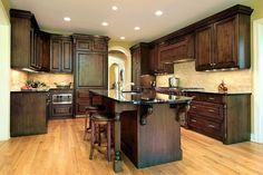 Light Hardwood Floor Kitchen with Dark Classic Oak Cabinets