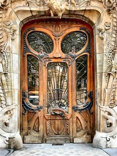 kenzotrufi:    Art Nouveau Doorway at 29 Avenue Rapp, Paris by Jules Lavirotte Reminiscent of an alien face