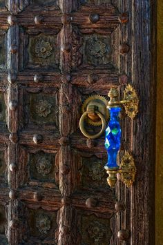 Beausejour villa, St Lucia...  This door is beautifully carved... Love the bright blue hardware!