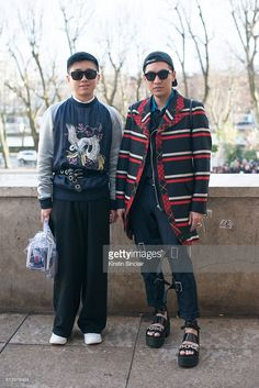 Fashion stylist Declan Chen wears a Louis Vuitton sweater and Loewe bag Fashion blogger and presenter Bryanboy wears a Comme des Garcons jacket and trousers and a Louis Vuitton bag on day 2 during Paris Fashion Week Autumn/Winter 2016/17 on March 2, 2016 in Paris, France. (Photo by Kirstin Sinclair/Getty Images)Declan Chen; Bryanboy