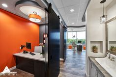 Orange Pops of Color in a Rustic Office. Dental Office Design by Arminco Inc.