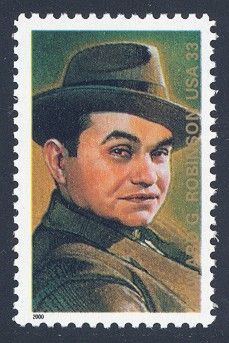 "USPS 2000 - Edward G. Robinson -   6th in Legends of Hollywood Series A versatile actor on both stage and screen, Edward G. Robinson (1893-1973) appeared in more than 90 films and is perhaps best known for his portrayal of a gangster in ""Little Caesar."" The stamp features a portrait by Drew Struzan that is based on a black-and-white photograph taken by Elmer Fryer, probably in the 1930s."