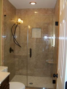 Small bathroom remodel psssh small bathroom hot damn Ill take that shower any day :)