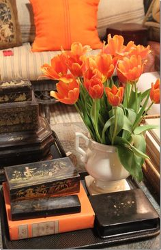 Pretty living room details - orange tulips & Chinoiserie boxes