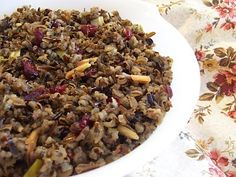 Slow cooker wild rice with cranberries. Use Earth Balance margerine for vegan.