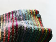 What a beautiful effect: colorful stripes slip-stitched on a neutral double crochet background.  Felted Button.