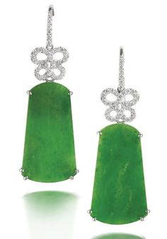 A pair of jadeite and diamond pendent earrings Each set with a bright green tapered jadeite plaques of very good translucency, measuring approximately 24.6 x 13.5 x 1.6mm, suspended by a stylised bow surmount set with brilliant-cut diamonds, mounted in 18k white gold, diamonds approximately 0.40 carat total, length 4.1cm