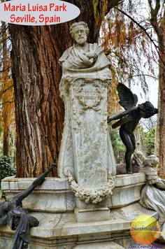 Becquer, the poet statue with Cupid at the Maria Luisa Park, a former royal garden donated to the city by the Queen
