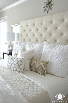 - Kelley: Master Bedroom Update- Calming White and neutral master bedroom with tufted ottoman stools, Pottery Barn Tall Lorraine Headboard, Diamond linen quilt and hadley ruched duvetKelley Nan: Master Bedroom Update