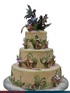Fairy bride and groom cake toppers on a mushroom cake