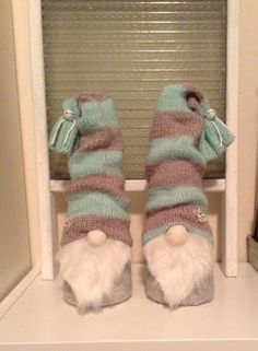Made out of socks and sweater selves.