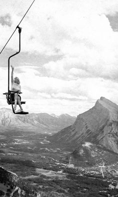 Marilyn Monroe waves as she ascends the chairlift at Mt. Norquay, with stunning Banff, Canada in the background.