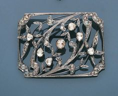 A belle époque diamond `plaque de cou`, circa 1900 The openwork rectangular plaque composed of rose-cut diamond scrolling foliage, flowerhead and bud motifs with millegrain detail, later rhodium plated, length 7.0cm., cased