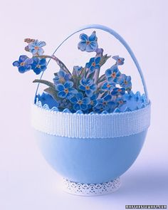 Egg Baskets    These baskets are made of eggshells filled with embossed paper flowers that honor the arrival of spring. Experiment by filling them with grass, velvet flowers, or even tiny Easter animal toys