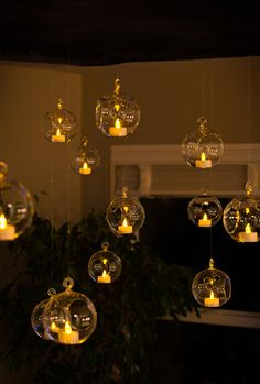 Putting battery powered candles in a hanging glass orb is a magical and romantic decorative piece for any occasion. -SvH