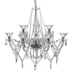 The Emma 9 light chandelier is a luxurious creation lavishly embellished with draping bead chains and pear shaped crystal glass droplets