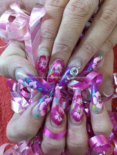 One stroke flower nail art with swarovski crystals over stiletto nails