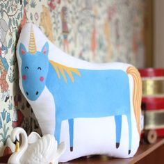 Check out our unicorn nursery decor selection for the very best in unique or custom, handmade pieces from our shops. Unicorn Cushion, Unicorn Pillow, Nursery Design, Nursery Decor, Kids Room Furniture, Muslin Swaddle Blanket, Baby Christmas Gifts, Printed Cushions, Baby Rattle
