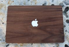 high quality real wood macbook walnut skin with a 3m™ pressure sensitive adhesive handmade item materials: wood, veneer, walnut just peel and stick natural hand rubbed wood finish made in the usfinished with a high quality natural and beautiful danish oil // the slits in the corners allow the wood to wrap around the curves of the macbook top