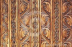 Old hand-carved wooden pattern on a monastery door