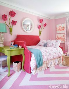 The daughter's bed is upholstered in a cheerful Manuel Canovas fabric.