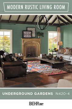 Rustic interior design gets a colorful twist thanks to BEHR® Paint in Underground Gardens. This rich green hue ties together this entire living room. Paired with leather couches, dark wood floors, an exposed beam ceiling, and overlapping rugs, it's the perfect look. Click below to learn more.